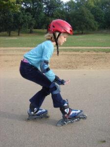 kid braking with inline skates