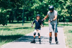 father and son rollerblading